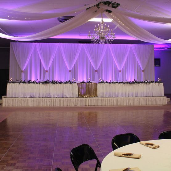 Purple lit wedding reception table and dance floor